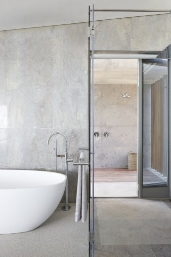 The combination of a floor standing bathtub mixer and tub add to the contemporary aesthetic