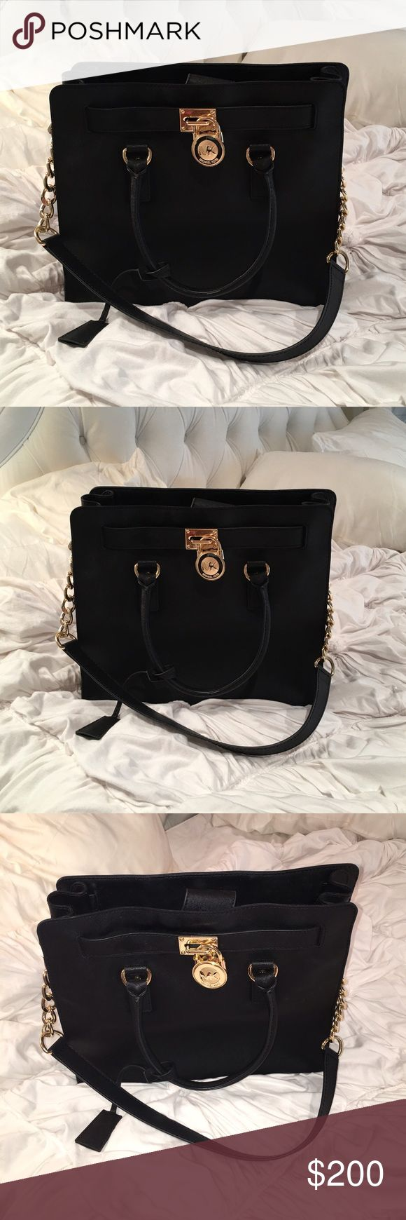 MICHAEL KORS black bag!!! MICHAEL KORS black bag!!! Used just a handful of times - great condition!!🚨 Will lower price 10% so you get free shipping too. 🚨 KORS Michael Kors Bags Totes