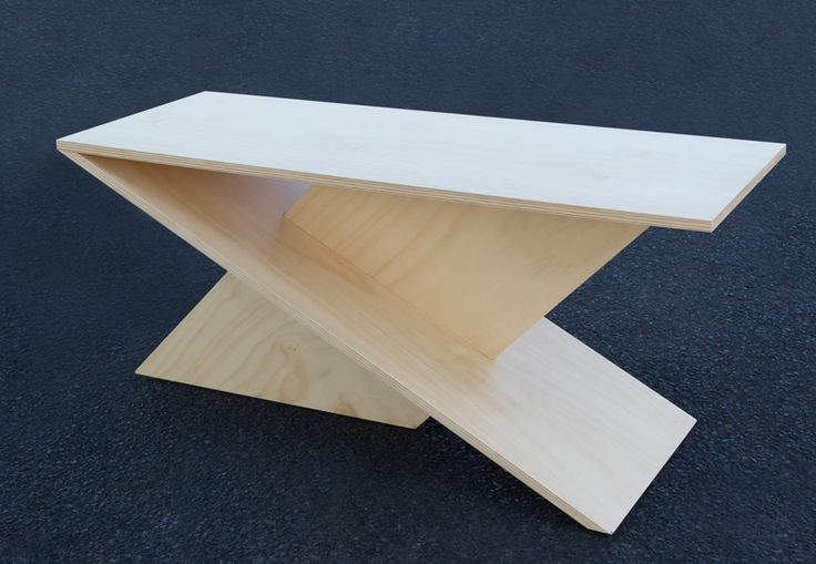 Acute table made of wood looks so great.