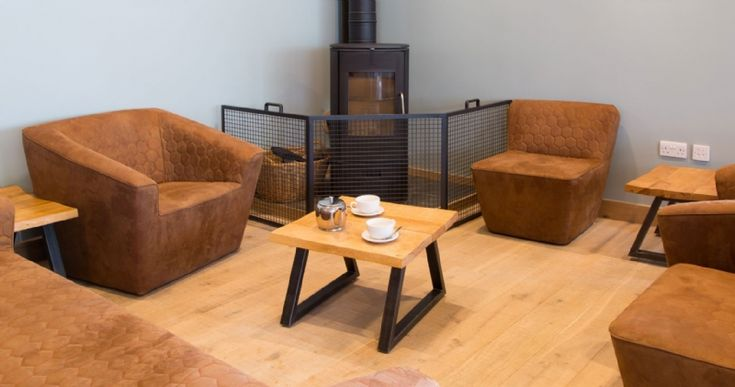 The Lanhydrock Cafe was specifically designed with the fireplace set into one corner of the room, Kernow Fires installed a Morso stove.   #morso #stove #fire #wood #burner #corner #fire #guard #cafe #lanhydrock #modern #contemporary #kernowfires #wadebridge #redruth #cornwall
