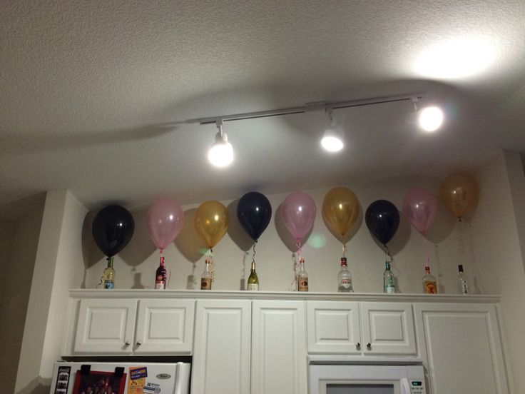 Good idea for hanging balloons for a twenty first birthday party #21 #balloons #winebottles