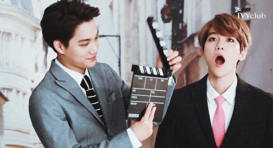 Here Kai is Being Handsome by just standing there and Where Baekhyun is just....Baekhyun <3 <3