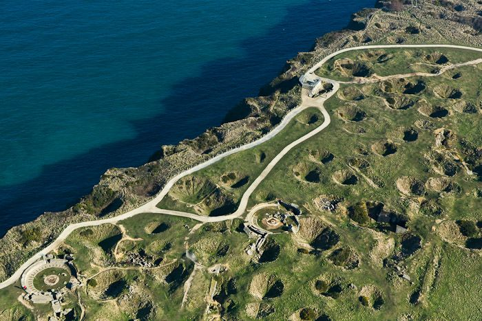 WWII D day remembrance. Pointe du hoc, Normandie, France. Check out the large artillery bomb craters caused by the US Navy prior to US troops invading the beach and cliffs.