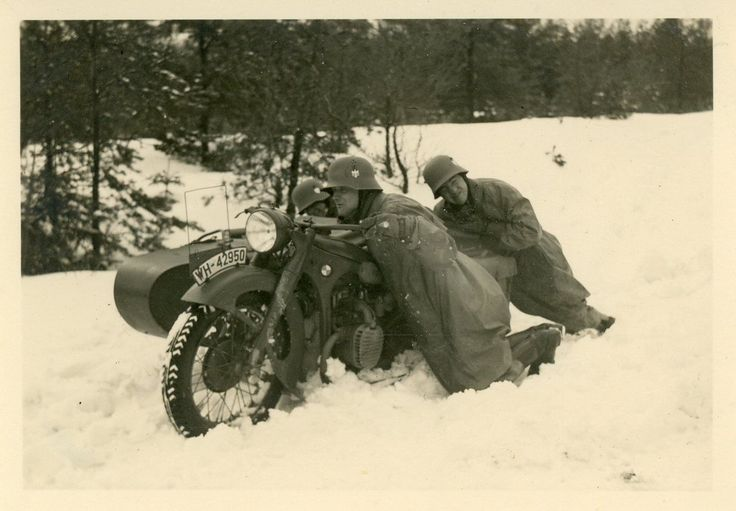 """German soldiers dislodge an army motorcycle from the snow, via Jedem das seine. Note the """"WH"""" (""""Wehrmacht Heer"""") registration plate."""