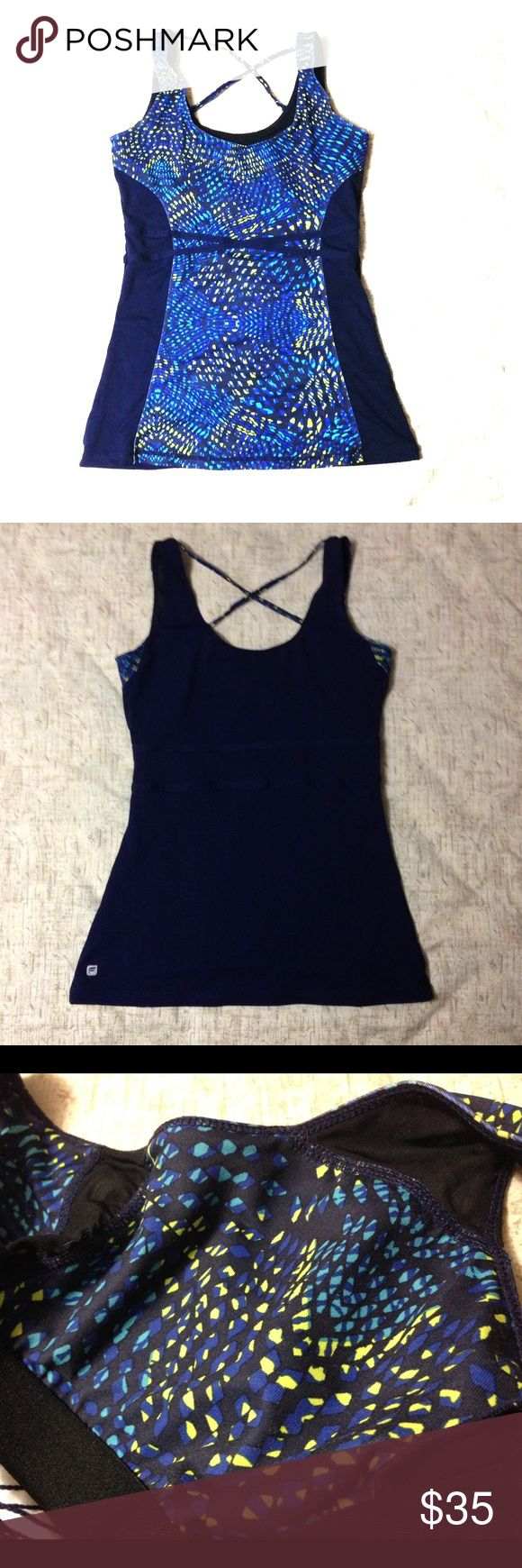 """Fabletics Hawthorne Tank Fabletics Hawthorne Tank in navy blue with geometric green and turquoise pattern in front. Crisscross design in upper back. Shelf bra has opening for cup inserts but I no longer have them. Only wore once. 25.5"""" from shoulder to bottom hem. Fabletics Tops Tank Tops"""
