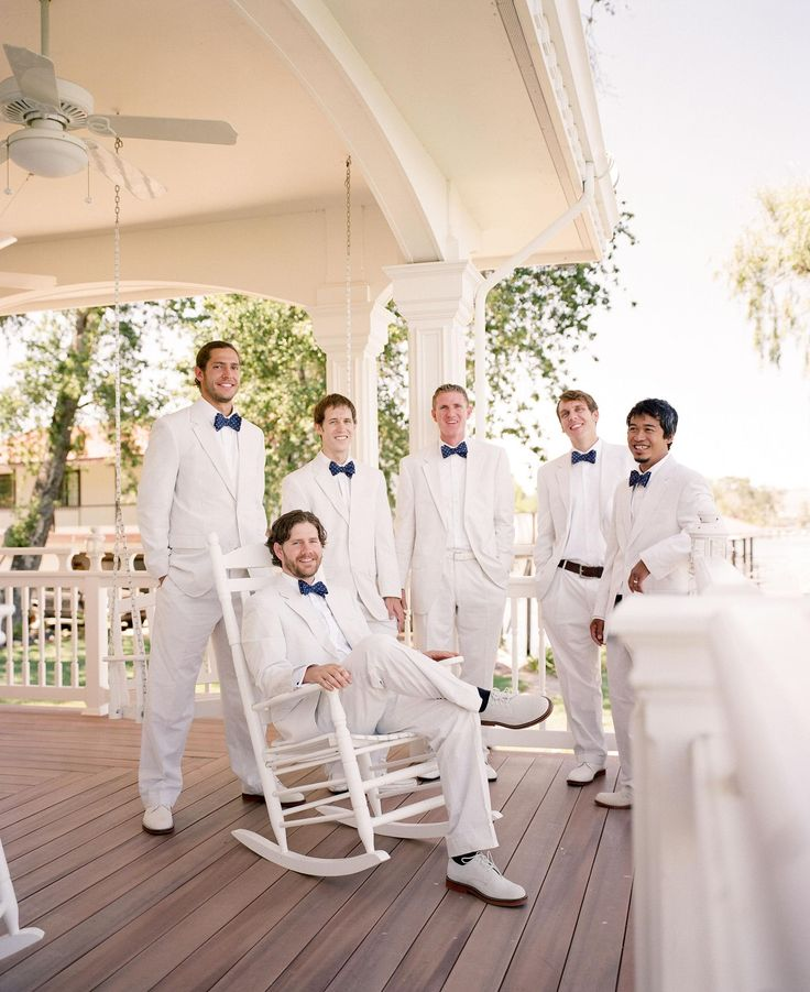 Groomsmen fashion, white suits, navy blue bowties, summer wedding style // Tanja Lippert Photography