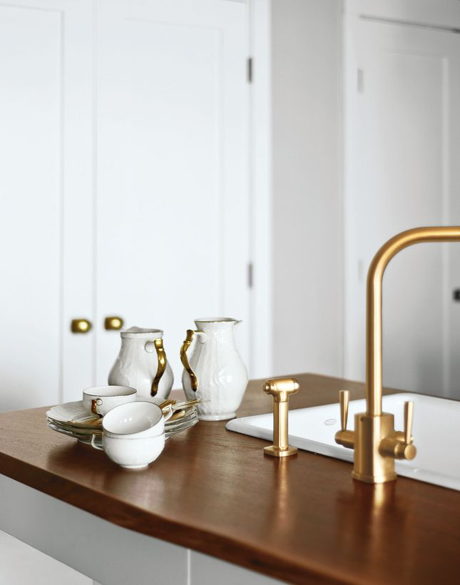 brass accents with wood: Idea, Houses, Brass Faucets, Brass Hardware, Interiors Design, Gold Accent, Wood Countertops, Modern Kitchens, Kitchens Faucets