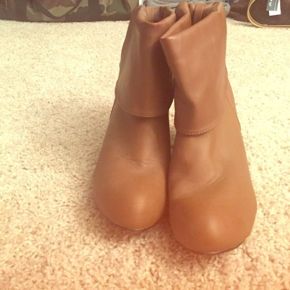 Brown Booties Heels Ankle Boots These are brown bootie heels. The heel is small and the cuff of the boot reaches the ankle. There are cute decorative buttons on the back. I never actually wore them so they are brand new! Make an offer!! Charlotte Russe Shoes Ankle Boots & Booties