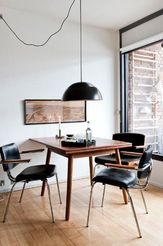 adding pattern to this brilliant black and natural wood dining space is super easy | photo by peter kragballe
