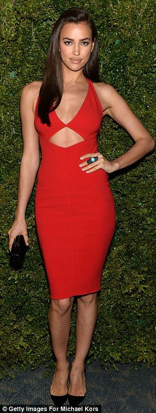 Scorching hot: The model, who is dating footballer Cristiano Ronaldo, spent her Saturday night in a stunning red dress as she attended a special dinner in honour of Halle Berry as she joins Michael Kors and the United Nations World Food Programme