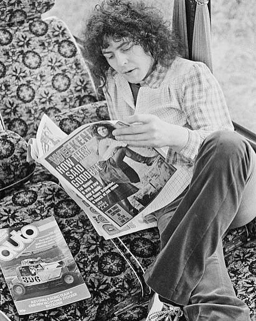 June 24th 1972 Marc reading a newspaper on a tour bus before a concert at Newcastle City Hall. (Photo by Michael Putland)