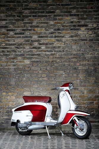 LAMBRETTA SX 200.....British...due to the added colour...the original Italian is all white...both...very cool.