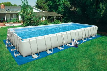Intex rectangle above ground pool with ground pad, A-frame ladder, and filter system.