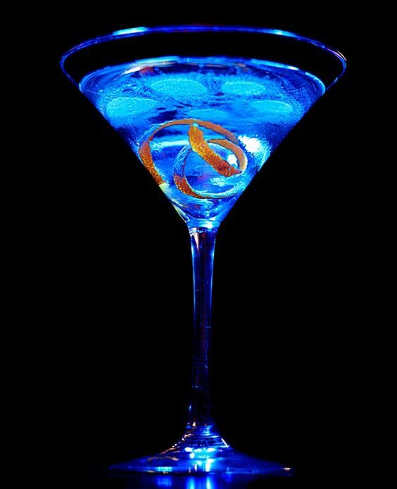 Blue Raspberry Martini  Ingredients:  2 ounces vodka  2 ounces raspberry liquor  twist of Curacao    SHAKE with ice and strain into martini glass