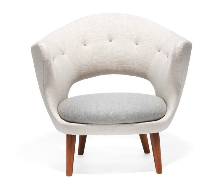 Finn Juhl // by Søren Willadsen, Vejen. Easy chair with round, tapering teak legs. Sides and back upholstered with light wool. Seat cushion and buttons in back upholstered with grey wool.