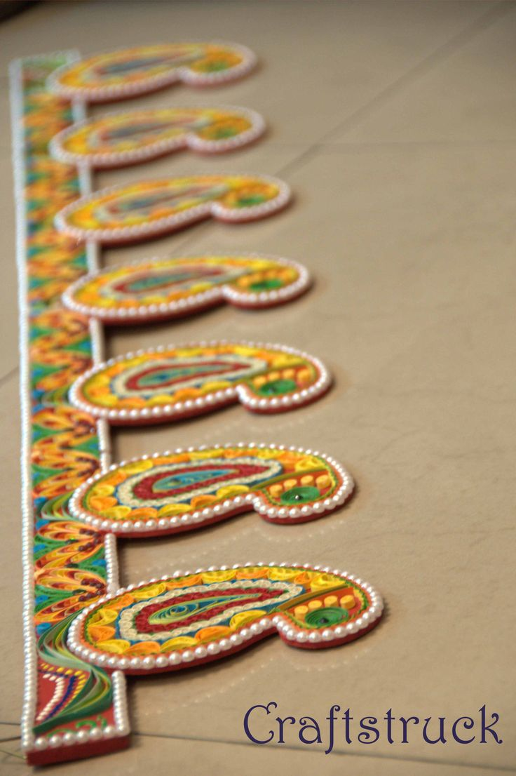 """Indian door hangings colloquially called """"bandanwar"""", lend a traditional and festive look to a home. these Decorative pieces are Hung at the entrance of the home, it comes in nice colors and combinations. This bandawar is approx. 2 feet 28 inches long and the height is 14 cm.. Base of the bandawar is of wood and it is made with paper quilling technique."""