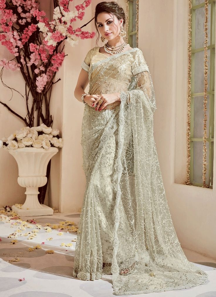 Sarees online shopping and check latest collection in silk sarees at india's best online shopping store. Buy this imperial net classic designer saree.