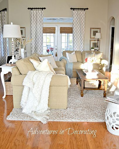 Drapes idea -maybe use fabric blinds on window behind couch but use drapes along the sides to make more of a visual impact.