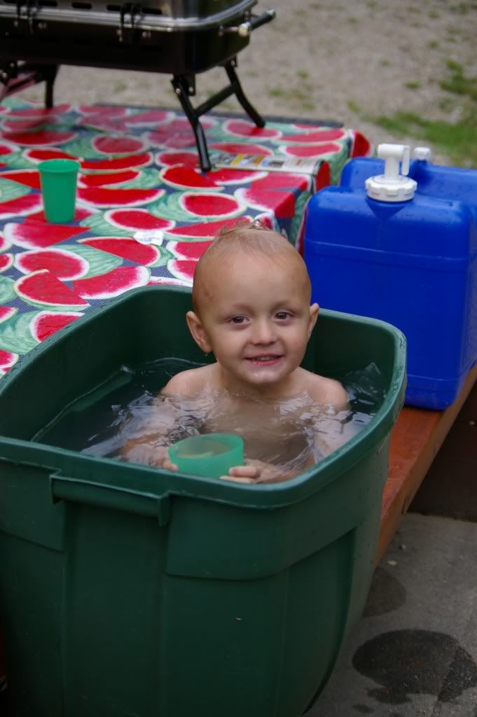 Camping tips: Dirty kiddo? Boil some water, add to cold water and let them clean up. A bathtub away from home!