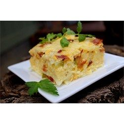 With bacon and vegetables in the mix, this egg and hash brown breakfast casserole is a step above the classic.