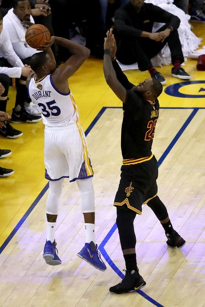 LeBron James Photos Photos - Kevin Durant #35 of the Golden State Warriors takes a shot against LeBron James #23 of the Cleveland Cavaliers in Game 2 of the 2017 NBA Finals at ORACLE Arena on June 4, 2017 in Oakland, California. NOTE TO USER: User expressly acknowledges and agrees that, by downloading and or using this photograph, User is consenting to the terms and conditions of the Getty Images License Agreement. - 2017 NBA Finals - Game Two