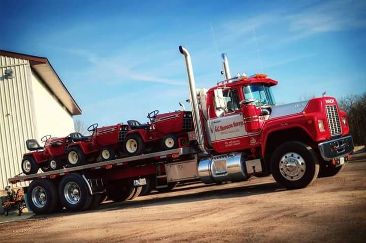 rollerman1:  Mack R model flat bed with a load of IH Cub Cader 82 series garden tractors