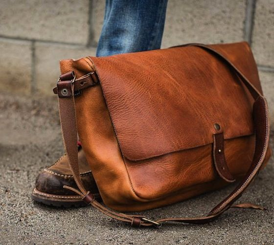 Vintage Messenger Bag by Whipping Post. 100% Vegetable Tanned Leather, Padded Laptop Storage Lined in Suede, Back Newspaper Pouch, Key Lanyard, Adjustable Padded Strap, As pictured with a 13″ laptop.  More info