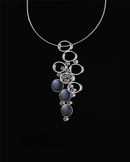 "Elis Kauppi for Kupittaan Kulta, ""Mountain Stream"" pendant, in precious metal with rock crystal bubbles over spectrolite pebbles, 1975. #Finland"