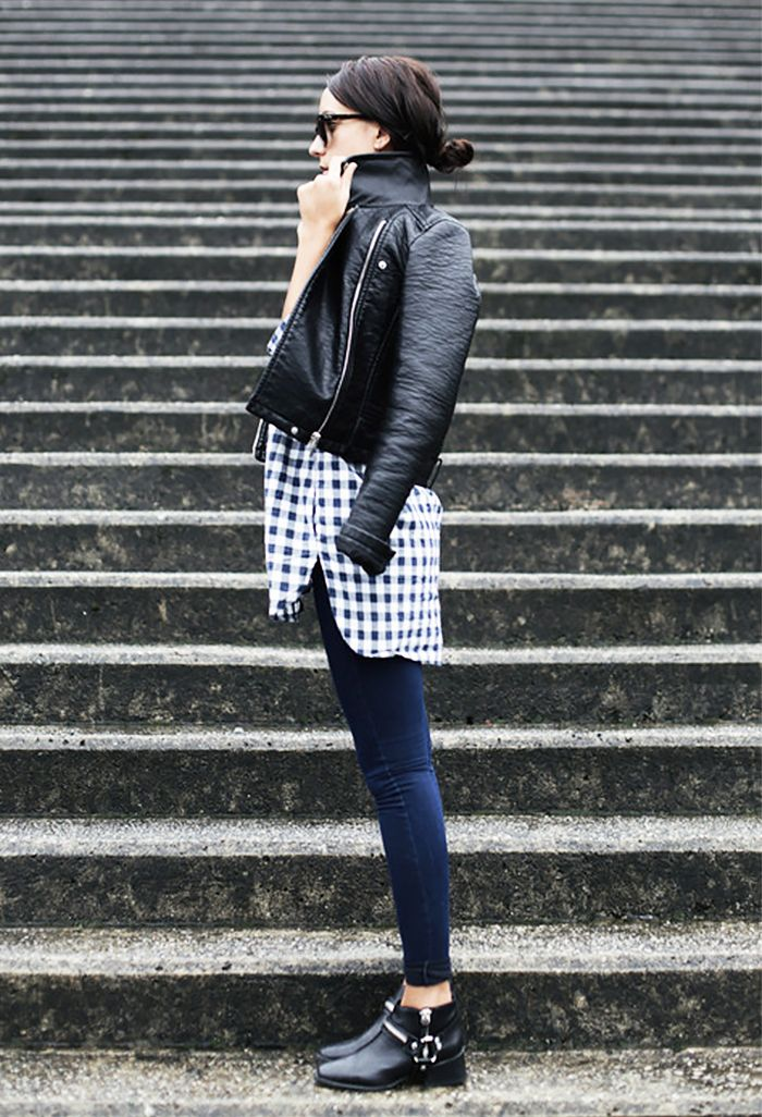 Black leather jacket worn over a gingham print top