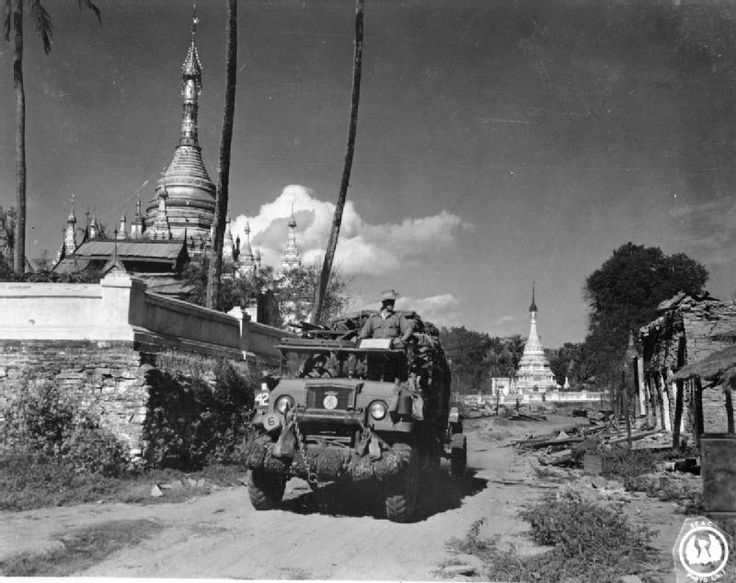 Burma Campaign, WW2: A lorry of the British 36th Infantry Division enters the town of Tigyiang during the advance down the Irrawaddy Valley towards Mandalay, 22 December 1944. Burma was Britain's longest campaign during WW2.