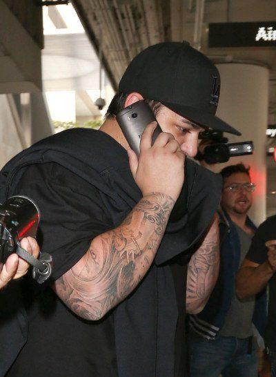 Rob Kardashian Fights with Family, Bails on Kim's Wedding