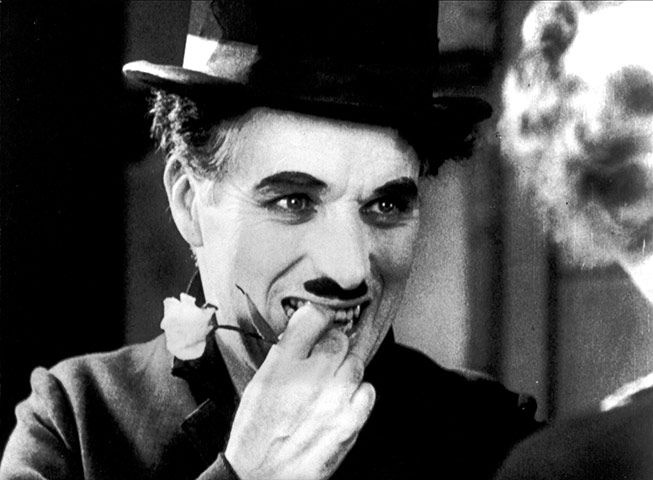 Charlie Chaplin (1889-1977) - a great pose of him in one of his early films.