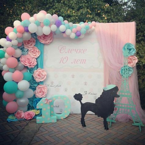Fun party decor and party backdrop for a Paris inspired party.