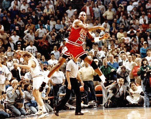 Michael Jordan celebrates after game-winning shots against Cavs in deciding Game 5 of NBA playoffs