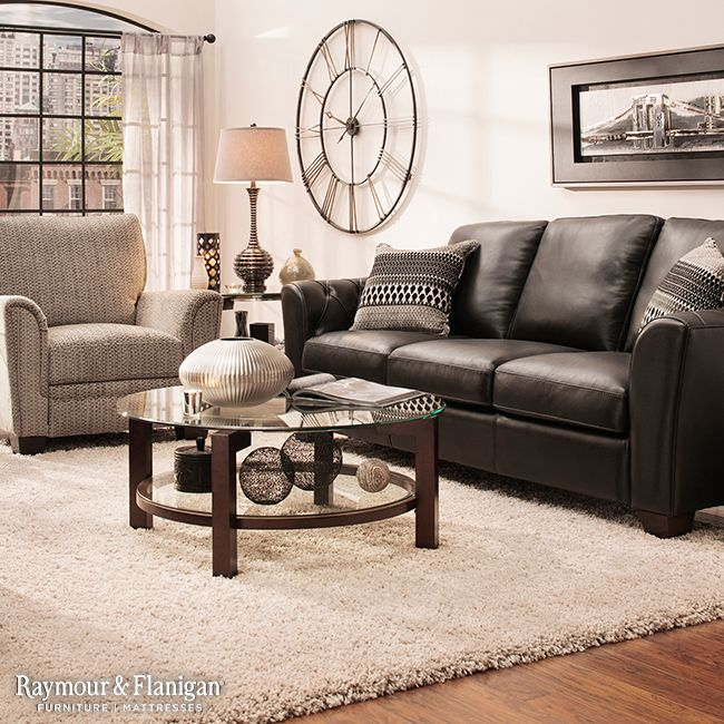 Is black leather more your style? Consider going contemporary with a black leather sofa by contrasting the dark upholstery with a bright rug and metallic accents.