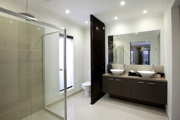 This stunning double en suite uses dark chocolate timbers to give a timeless style.