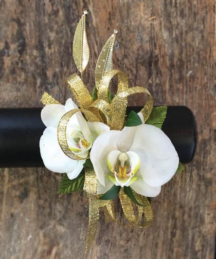 "The stars align during this month  with this fabulously vintage wrist corsage that features white orchids and gold leaves. Approx. 4"" (H) x 3"" (W)."