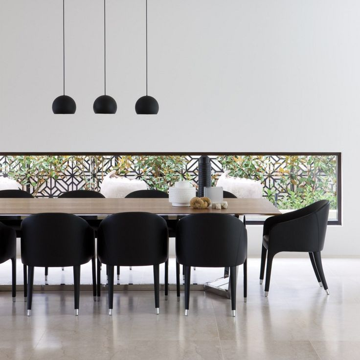 Dining Room With Dark Chairs And Contrast Pendant Lights