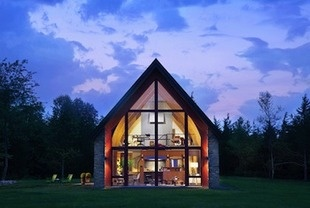 With its exterior stonework, timber frame, and pitched roof, the Hudson Passive Project in the Hudson River Valley, is New York State's first Certified Passive House.
