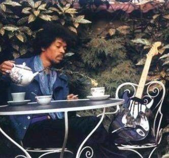 Jimi Hendrix enjoying some tea with his Strat.