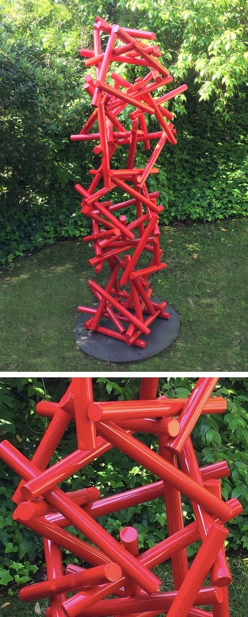 Our modern Gravity sculpture in poppy. It's the perfect abstract piece to take center stage in your garden.