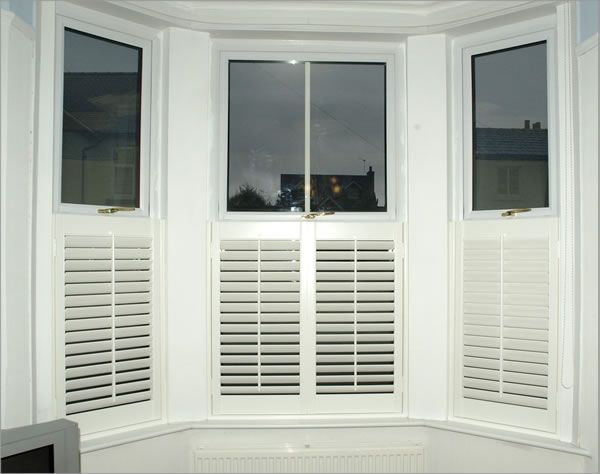 Plantation shutters - cafe style by  Supplied and Installed by Shutter Master.  www.shuttermaster.co.uk