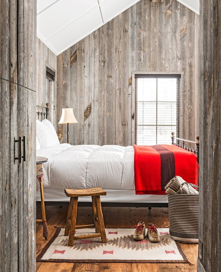 Love the gray wood paneling and Scandinavian design of this cabin.