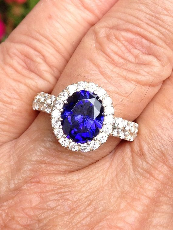 Something like this ring (or necklace or bracelet)  to match my earrings. Vintage 4 ct ceylon sapphire & cz sterling ring  by DriftwoodStorm, $59.00