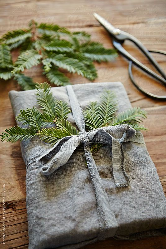 Recycled Gift Wrap: Why not wrap a gift with another gift? Turn a vintage hand towel into a practical and beautiful wrapping material. The finishing touch: a sprig of balsam or other greenery.
