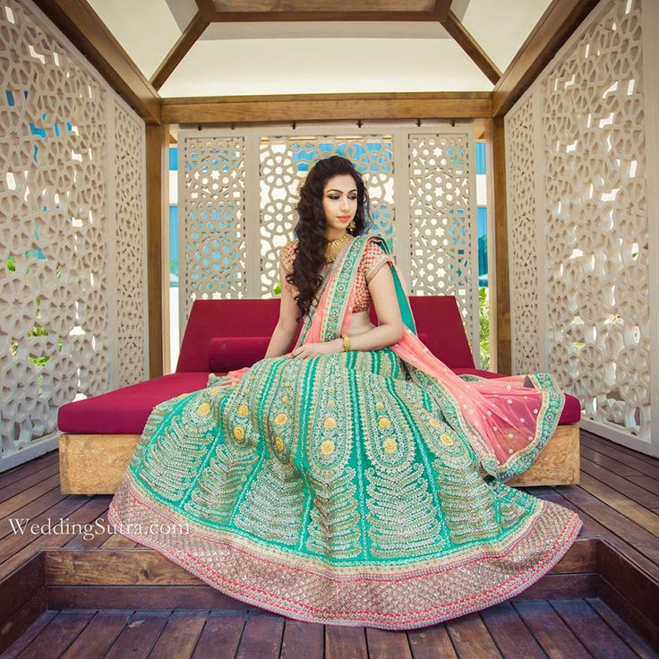 Mint Green Lehenga A Gorgeous Red Blouse And Peach Net Dupatta With Intricate Embroidery By