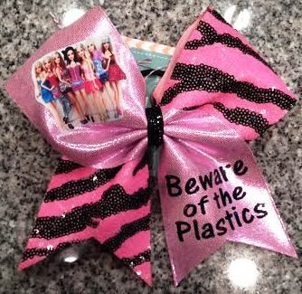 Bows by April - Beware the Plastics Pink Mystique and Zebra Sequins Cheer Bow, $18.00 (http://www.bowsbyapril.com/beware-the-plastics-pink-mystique-and-zebra-sequins-cheer-bow/)