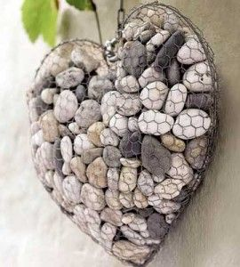 A Piece of discarded Chicken wire, and a few collected pebbles! I think this would be pretty inside or out. I think it would a;lsao be attractive with the 'frame' sprayed a Flat Black for extra contrast. - Wire and Stone Heart - Beautify your yard or garden with this decorative DIY home decor craft project made from wire and pebbles. Short tutorial.