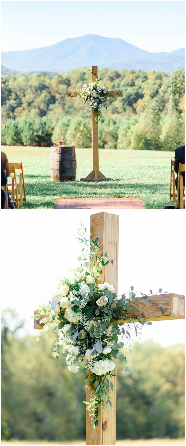 do you invite officiant to wedding reception%0A Religious outdoor wedding ceremony  wooden cross  cream florals  Virginia  wedding  traditional