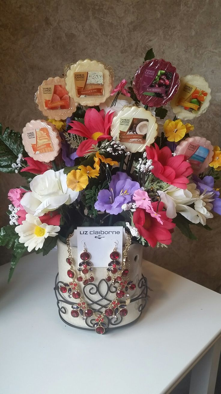 Homemade mother's day gift. The pot is a sensi pot and mixed in with the flowers is Yankee Candle for the sensi pot. Also added a earring and neclace set. DIY mother's day gift. #MOTHERSDAY #DIY #GIFT